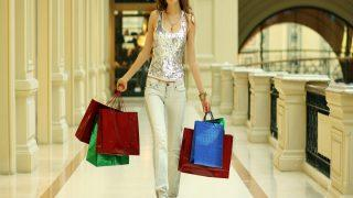 Full length Portrait of a beautiful young lady out shopping with